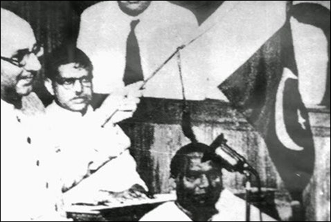 Pakistan's first PM Liquat Ali Khan waving the Pakistani flag in the Constituent Assembly in 1947.