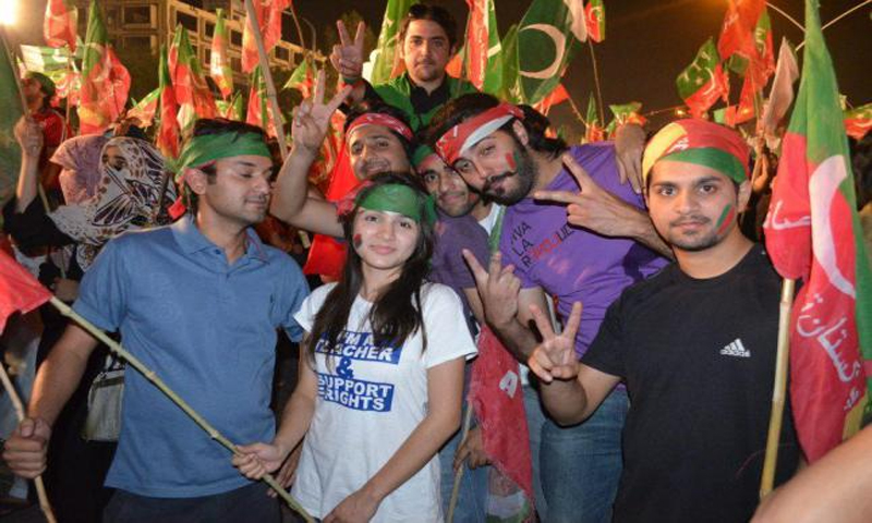 PTI workers carrying their flags