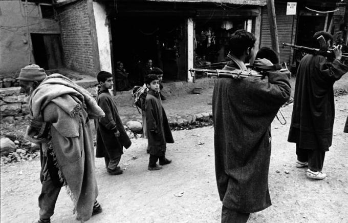 1989: Armed gangs of Kashmiri separatists patrolling a street of a town in J&K. Rising violence in the valley saw the exodus of hundreds of Hindu families from the area.