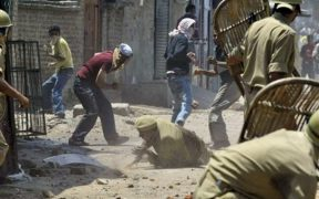 A policeman falls on the ground during a clash between protestors and police in Srinagar, India, Tuesday, June 24, 2008. Hundreds of Kashmiris attacked a police post in Indian-controlled Kashmir on Tuesday to protest the killing of a local resident by police during demonstrations against the transfer of forest land to a Hindu shrine in the Muslim-majority region, police said. (AP Photo/Mukhtar Khan)