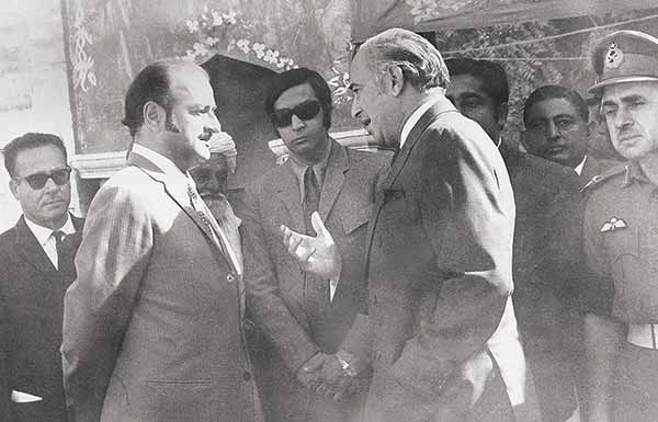 PM Bhutto (right) talking to Sindh CM outside Shah Latif's shrine in 1973.